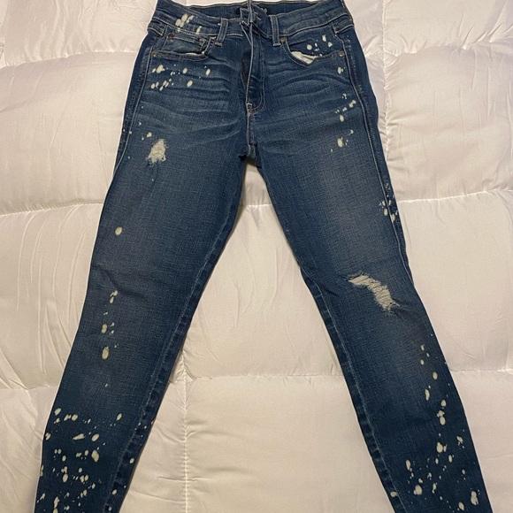 Level 99 paint splattered skinny jeans in size 26
